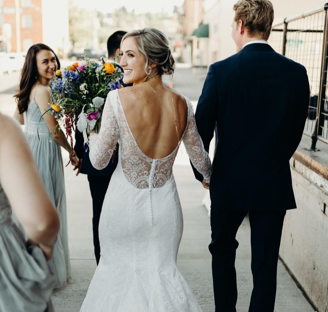 Bride wearing a Marcella's Bridal custom wedding dress
